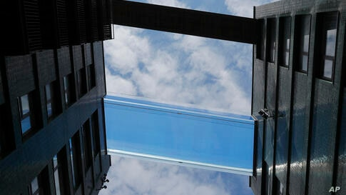 The world's first sky pool with a glass bottom, 115 ft (35m) above the streets in London, Tuesday April 27, 2021. The sky pool…