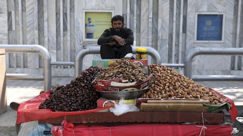 A street vendor sells dates on the first day of the Muslim holy fasting month of Ramadan, in Kabul, Afghanistan, Tuesday, April…