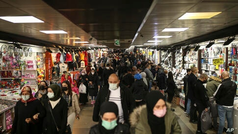 People walk in an underpass of the Eminonu open market in Istanbul, Friday, April 2, 2021. The number of confirmed COVID-19…