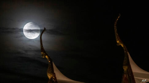A  view of the moon observed behind the Suthat temple in Bangkok, Thailand, Wednesday, May 26, 2021. The first total lunar…