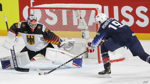 Jason Robertson of the US scores his side's opening goal during the Ice Hockey World Championship group B match between United…
