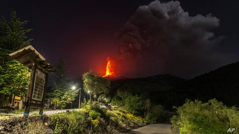 Lava gushes from the southern side crater of Mt. Etna, Europe's largest active volcano, near Catania, southern Italy Sicily,…