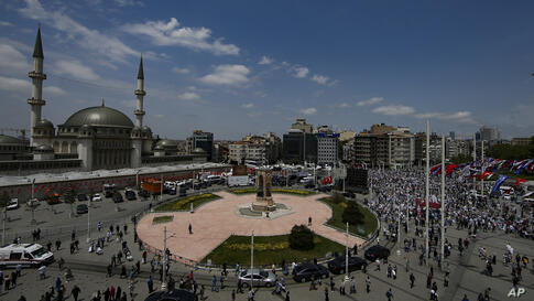 People pray outside the newly built Taksim Mosque at the Taksim Square in Istanbul, Friday, May 28, 2021. Turkish President…