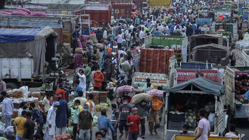Indians crowd a vegetable market in Jammu, India, Tuesday, May 4, 2021. COVID-19 infections and deaths are mounting with…