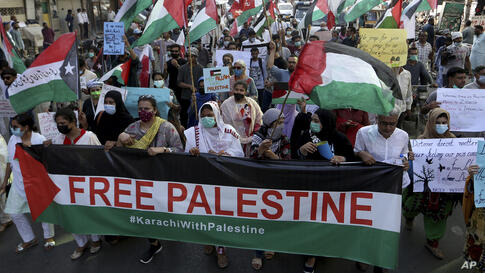 People take part in a rally in support of Palestinians, in Karachi, Pakistan, Thursday, May 20, 2021. (AP Photo/Fareed Khan)