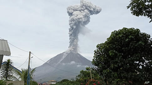 Mount Sinabung releases volcanic materials during an eruption in Karo, North Sumatra, Indonesia, Friday, May 7, 2021. Sinabung…