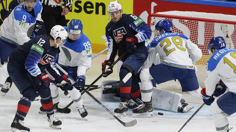 Trevor Moore of the US (12) scores his side's second goal during the Ice Hockey World Championship group B match between United…