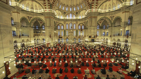 Muslims offer prayers during the first day of Eid al-Fitr, which marks the end of the holy month of Ramadan at Fatih Mosque in…
