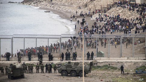 Spanish Army take positions at the border of Morocco and Spain, at the Spanish enclave of Ceuta, on Tuesday, May 18, 2021…