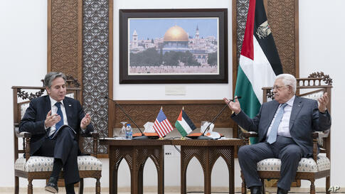 Secretary of State Antony Blinken listens during a joint statement with Palestinian President Mahmoud Abbas, Tuesday, May 25,…