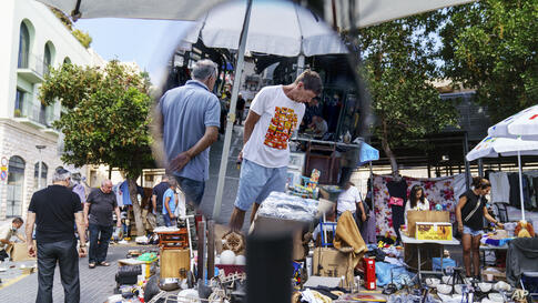 Shoppers stroll through the flea market in Jaffa, Israel, Monday, May 24, 2021, days after a cease-fire was reached in the 11…