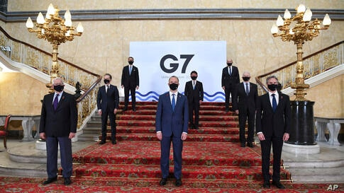 G7 foreign ministers wear face masks and are socially distanced for a group photo, with front row from left, European High…