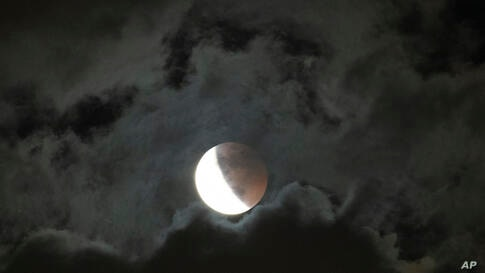 A lunar eclipse occurs in Manila, Philippines, Wednesday, May 26, 2021. The first total lunar eclipse in more than two years…