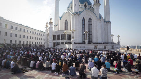 Muslims take part in Eid al-Fitr prayers at the Kul Sharif Mosque in Kazan, Russia, Thursday, May 13, 2021. Millions of Muslims…