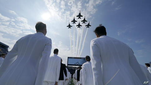 The Blue Angels fly over the graduation and commissioning ceremony at the U.S. Naval Academy in Annapolis, Md., Friday, May 28,…