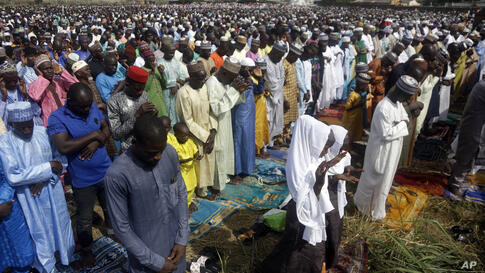 Muslims perform an Eid al-Fitr prayer in an outdoor open area in Lagos, Nigeria, Thursday, May 13, 2021. Millions of Muslims…