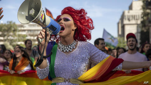 A participant dances in the annual Gay Pride parade in Jerusalem, Thursday, June 3, 2021. Thousands of people marched through…
