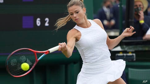 Italy's Camila Giorgi plays a return to Switzerland's Jil Teichmann during the women's singles first round match on day three…