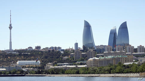 A general view of the Old City with the Flame Towers skyscrapers in background in Baku, Azerbaijan, Monday, June 7, 2021. (AP…
