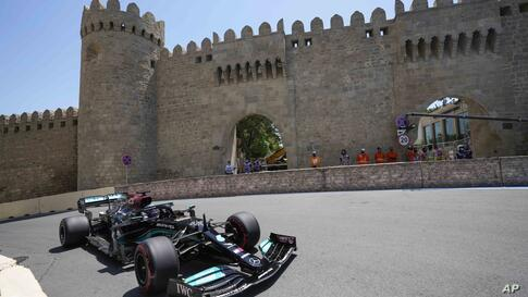 Mercedes driver Lewis Hamilton of Britain steers his car during the first free practice at the Baku Formula One city circuit,…