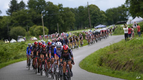 The pack rides during the third stage of the Tour de France cycling race over 182.9 kilometers (113.65 miles) with start in…