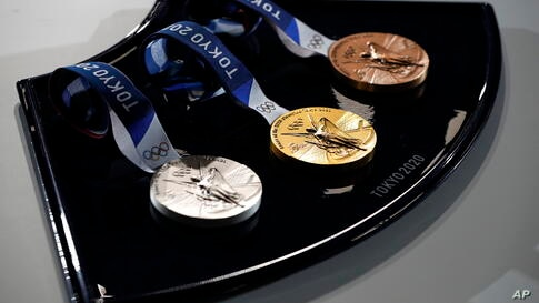 A medal tray that will be used during the victory ceremonies at the Tokyo 2020 Olympic and Paralympic Games is displayed during…