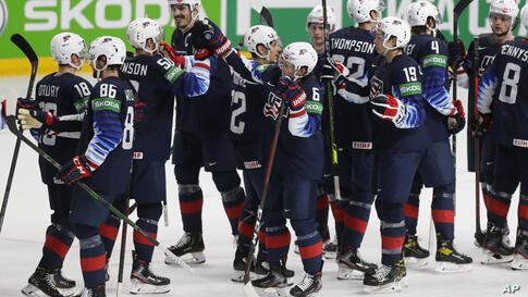 United States players celebrate their 6-1 victory during the Ice Hockey World Championship quarterfinal match between the…