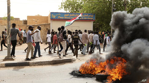 Sudanese take part in a protest over economic conditions, in Khartoum, Sudan, Wednesday, June 30, 2021. The World Bank and the…