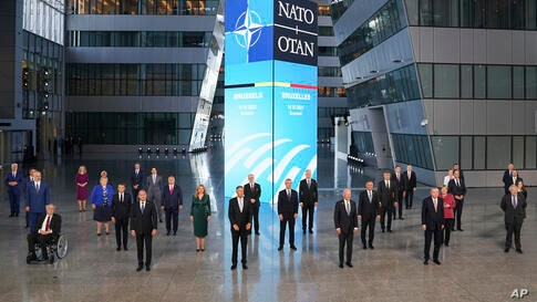 President Joe Biden and other NATO heads of the states and governments pose for a family photo during the NATO summit at the…
