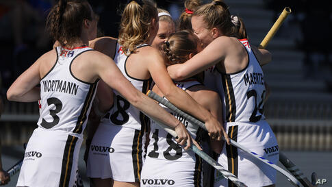 German players celebrate scoring their side's first goal during the women's pool B field hockey match between England and…