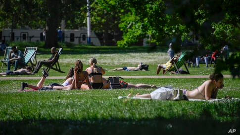 People enjoy the sun at St James's Park in London, Tuesday, June 1, 2021. Britain sees temperatures increasing for the second…