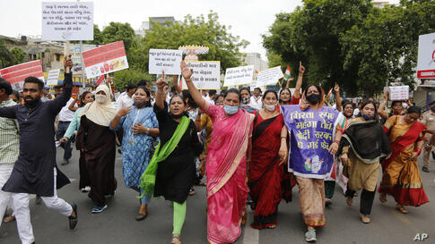 India's opposition Congress party supporters shout slogans during a protest against hike in fuel prices in Ahmedabad, India,…
