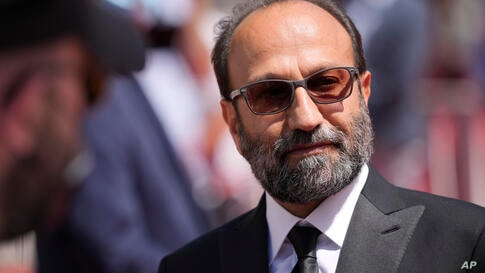 Director Asghar Farhadi poses for photographers upon arrival at the premiere of the film 'A Hero' at the 74th international…