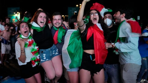 Italy's fans celebrate in Rome, Monday, July 12, 2021, after Italy beat England to win the Euro 2020 soccer championships in a…