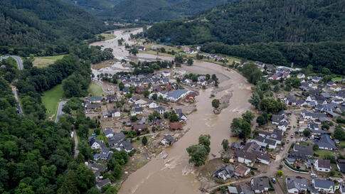 The Ahr river floats past destroyed houses in Insul, Germany, Thursday, July 15, 2021. Due to heavy rain falls the Ahr river…