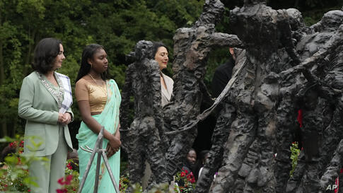 Mayor Femke Halsema, left, lays a wreath at the National Slavery Monument after apologizing for the involvement of the city's…