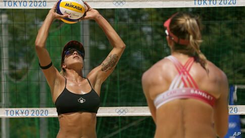 Brandie Wilkerson, left, and Heather Bansley, from Canada, practice during women's beach volleyball practice at the 2020 Summer…