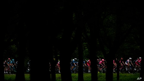 The pack rides during the tenth stage of the Tour de France cycling race over 190.7 kilometers (118.5 miles) with start in…