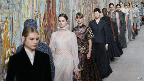 Models wear creations for Dior's Haute Couture Fall-Winter 2021-2022 fashion collection presented Monday, July 5, 2021, in…