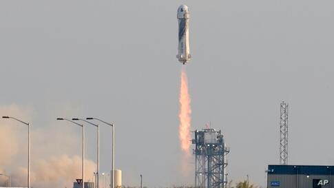 Blue Origin's New Shepard rocket launches carrying passengers Jeff Bezos, founder of Amazon and space tourism company Blue…