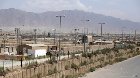 Blast wallls and a few buildings can be seen at the Bagram air base after the American military left the base, in Parwan…