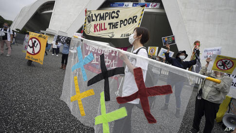 People against Olympic Games protest near Komazawa Olympic Park, where the unveiling ceremony for Olympic Flame of the Tokyo…