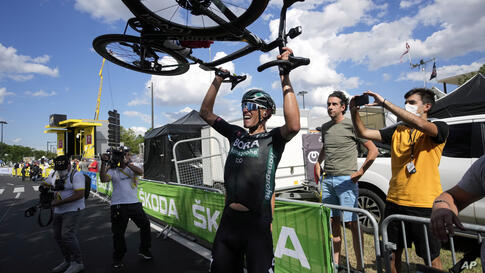German Nils Politt celebrates after winning the twelfth stage of the Tour de France cycling race over 159.4 kilometers (99…