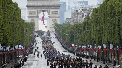 Troops walk down the Champs-Elysees avenue during the Bastille Day parade, Wednesday, July 14, 2021 in Paris. France is…