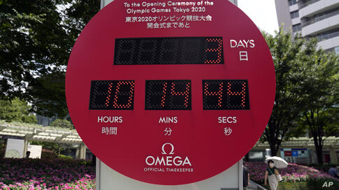 A Tokyo 2020 Olympic countdown clock displays 3 days to the opening ceremony, Tuesday, July 20, 2021, in Tokyo. (AP Photo…