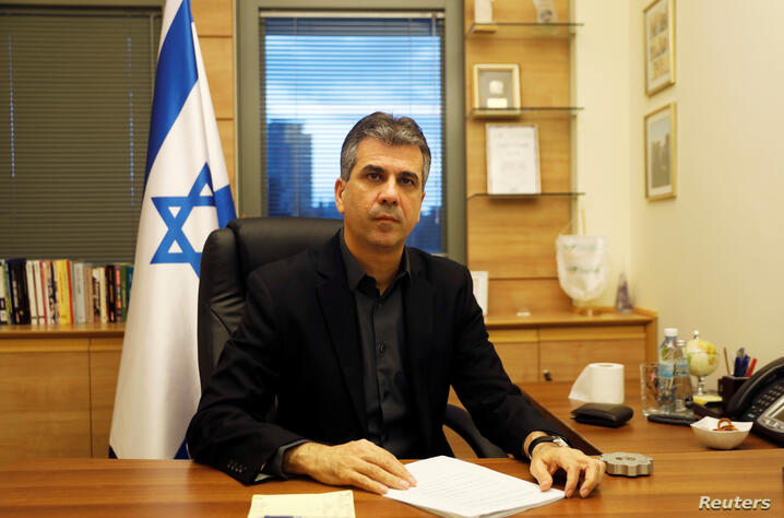 Israel's Economy Minister Eli Cohen poses for a picture at his office in the Knesset, the Israeli parliament, in Jerusalem…
