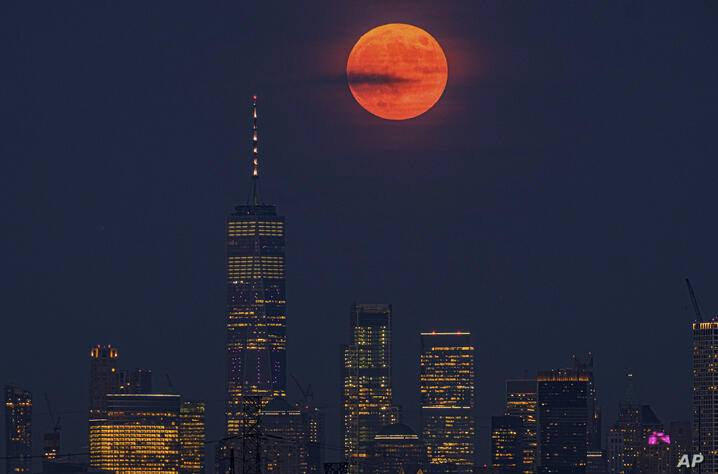 The full moon rises above the New York City skyline on the 50th anniversary of the Apollo 11 moon launch, Tuesday, July 16,…