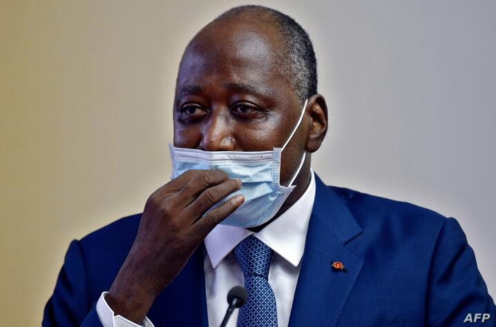 (FILES) In this file photograph taken on July 2, 2020 Ivory Coast Prime Minister and ruling party's candidate in the October…