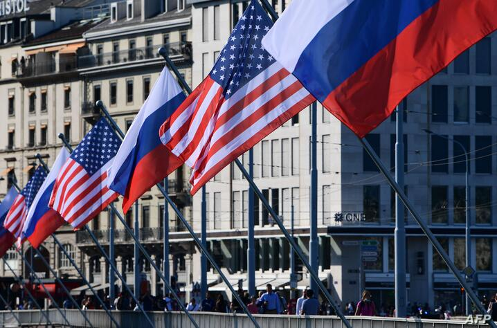 US and Russian flags fly on the Mont-Blanc bridge on the eve of a US-Russia summit, on June 15, 2021 in Geneva. (Photo by…