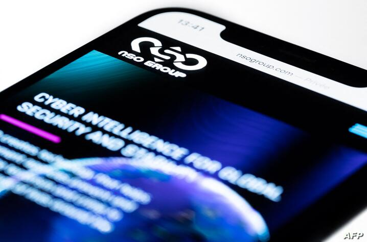 This studio photographic illustration shows a smartphone with the website of Israel's NSO Group which features 'Pegasus'…